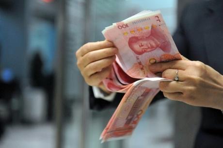 China shares resume with modest losses, yuan firms despite trade slump